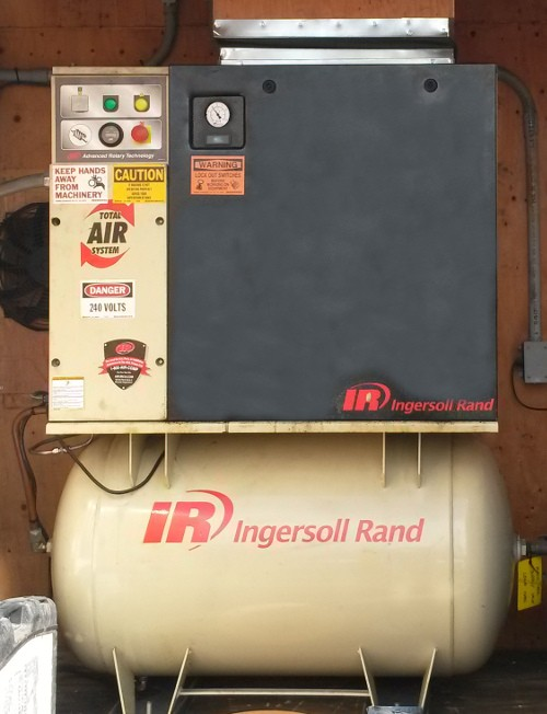 Rotary screw air compressor used in ozone remediation system